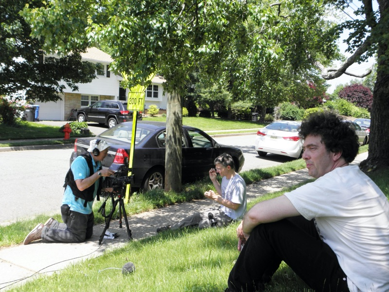 John Cooley being interviewed by the New York Times in Metuchen with David Rothenberg in the foreground